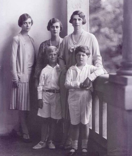 Princess Theodora (left), Princess Margarita (middle) and Prince Philip (in white shoes) visiting their 1st cousin Princess Helen of Romania (nee of Greece and Denmark) and her son Michael, the boy king.