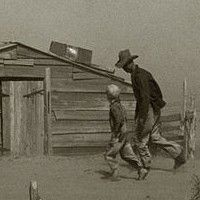 Farmer and Sons Walking in Dust Storm Cimarron County Oklahoma, April 1936 Photograph by Arthur Rothstein.