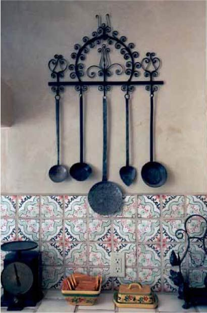 """Rustic kitchen. Links to the Taos News """"Enchanted Homes"""" section."""