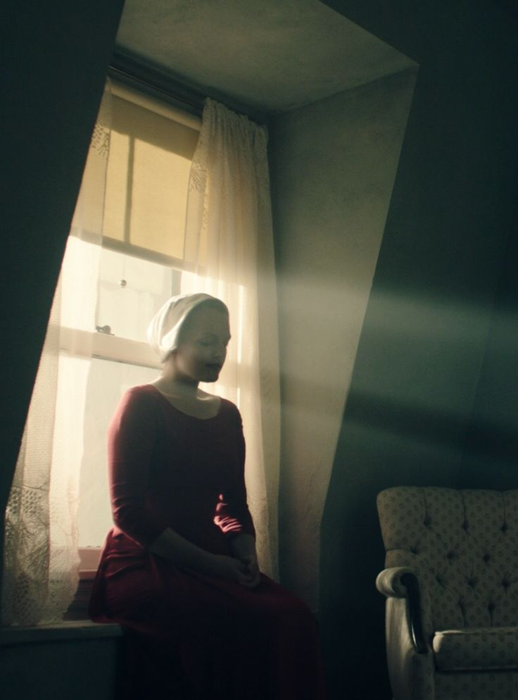 Men Darkly Rule Over Women In Photos From The Handmaid's Tale #refinery29  http://www.refinery29.com/2016/12/131854/the-handmaids-tale-first-photos-hulu#slide-3  Joseph Fiennes as the Commander, the mild-mannered head of the house, prepares himself for a night with a maiden. Likely Offred, who he develops a special relationship with....