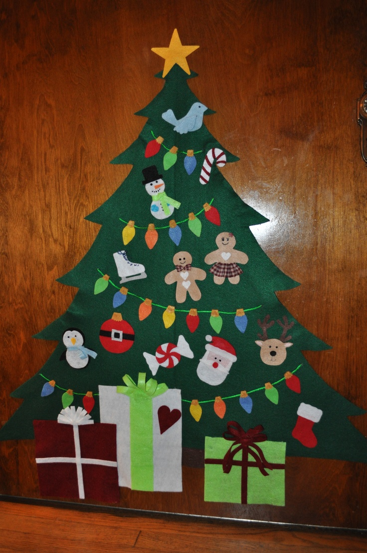 """Felt Christmas Tree - This is my version of the Felt Christmas Tree I cased from Pinterest.  I also cased all of the ornament ideas from multiple Pinterest pins too.  Everything is made from felt and hot glue.  I did permanently hot glue the lights on (they were hard for adults to """"hang"""" on the tree).  Thank you Pinterest people for helping me make a great decoration for my lil' girl (1 1/2 yrs) and start making Christmas traditions and memories!  She loves it.  MERRY CHRISTMAS TO ALL!"""