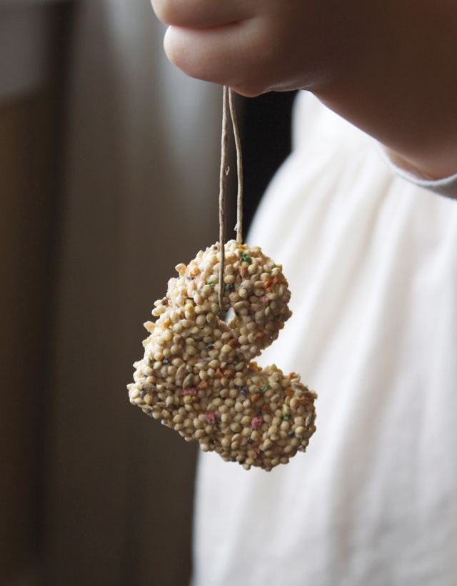 Toddler Craft: Bird Feeders    All you need is:    3/4 C. flour  1/2 C. water  1 envelope unflavored gelatin  3 TBS corn syrup  4 C. bird seed  Mix everything together except the bird seed.  Then add the bird seed, flatten out on a greased/lined cookie sheet.  cut shapes and allow to dry overnight.