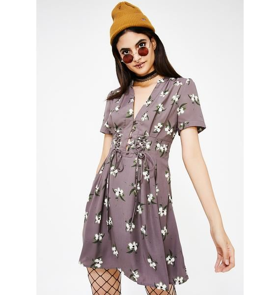 Sonoma Fields Floral Dress is nothing but easy pickings. This cute, skater dress features an allover floral pattern, pleated and lace up details, and a v-neckline.
