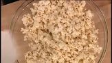 Martha Stewart makes healthy spicy organic popcorn you can serve for your Super Bowl party.