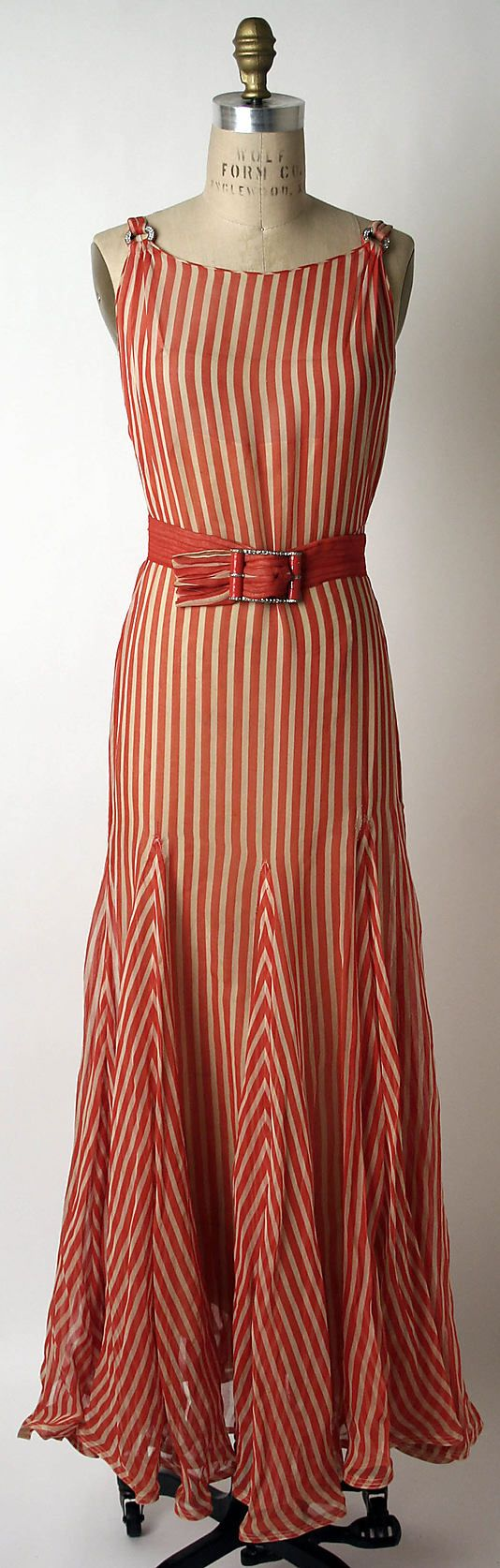 evening dress of sheer striped fabric (probably organdy or organza) w/ 8-gored skirt (instead of bias all over, just the gores are bias) & 4 shoulder rings (2 front, 2 back) part of Evening Ensemble (also includes a cape w/ tie, pleated belt & nude slip) by Norman Norell for Hattie Carnegie Inc, ca. 1932