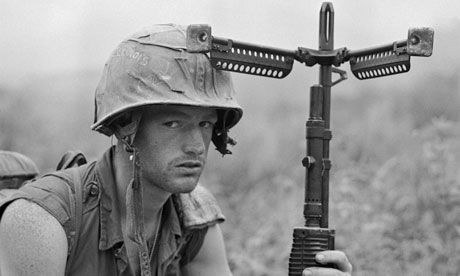 An American soldier after the capture of Hill 471, near the northern border of Khe Sanh, Vietnam, April 1968. Photograph: Bettman/Corbis.    Linked to article on McCrystal's call to reinstate the draft.  Vietnam War