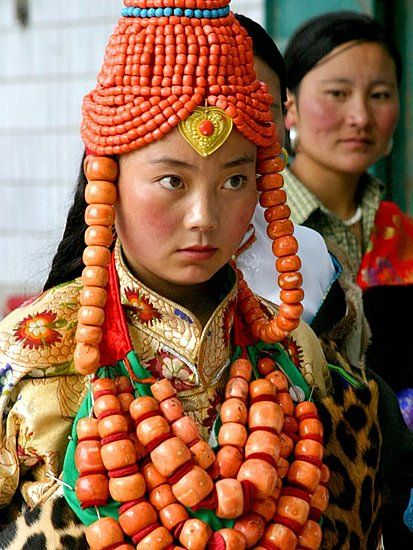 Tibet | Traditional regional costume and headdress of Khampa Tibetans. These costumes are the most prized possessions of the wearers' families.