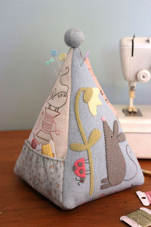 Mouse pincushion front - back has a triangle pocket to hold a small pair of scissors and a small needlebook