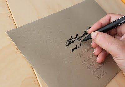 Fake calligraphy: print addresses in fancy fonts in light opacity and then trace over them with a paint pen. GENIUS.