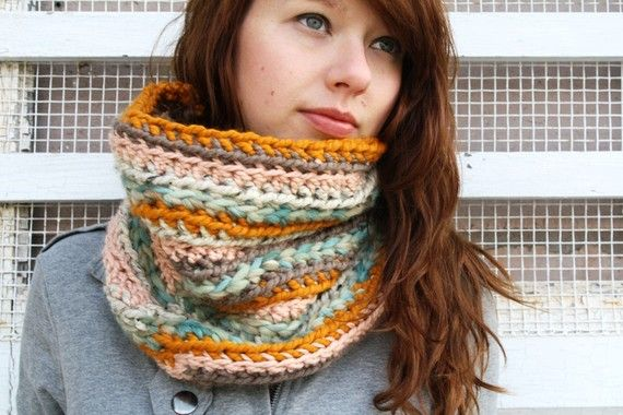 Love this... cozy scarf is made out of multiple yarns with various hues, textures, and thicknesses...   No pattern... Check out the off white one on my yarn board...