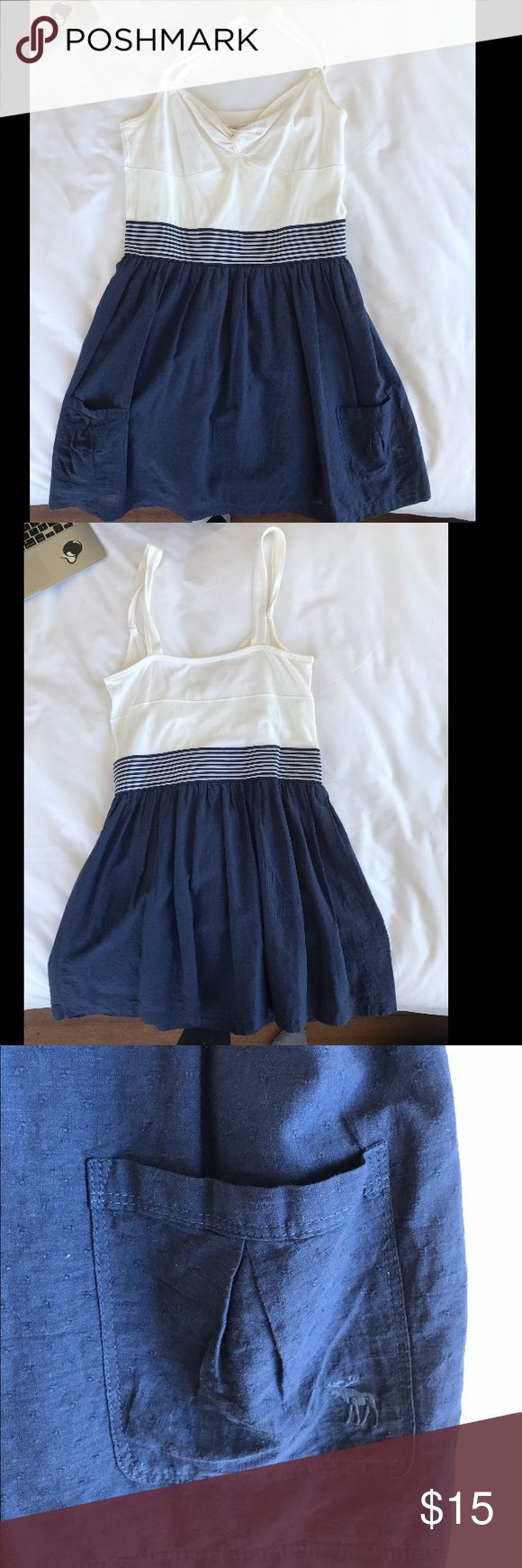 Abercrombie and fitch dress Dress is in great pre owned condition. It has two pockets on the bottoms sides of the dress. The white part is a very soft comfortable material. Great for going to the beach or dinner during the summer.  Make me an offer. Abercrombie & Fitch Dresses Mini