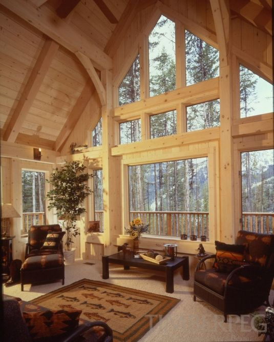 Best 25 post and beam ideas on pinterest barn loft for Timber frame sunroom addition