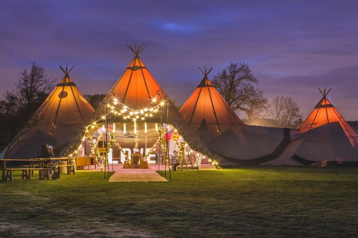 Three Giant hat tipis and chill out tipi by night - Sami Tipi Starlight Social captured by Christopher Terry