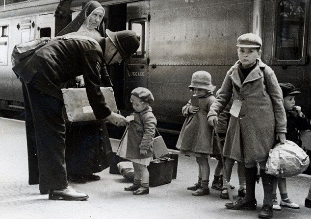 A policeman makes sure some young evacuees are on the correct train out of London