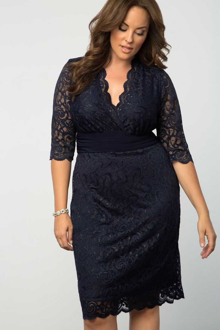 Attend your next special occasion in our gorgeous plus size Lumiere Lace Dress. This beautiful navy blue cocktail dress features a flattering waistband and glittered lace. Shop our entire made in the USA collection online at www.kiyonna.com.