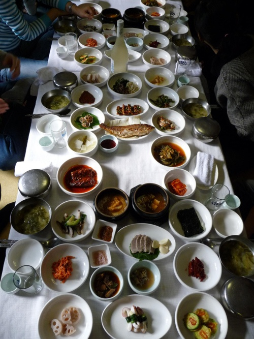 Korean food... This picture captures how beautiful Korean tables are with all there condiments:) love it!!! I should paint this..