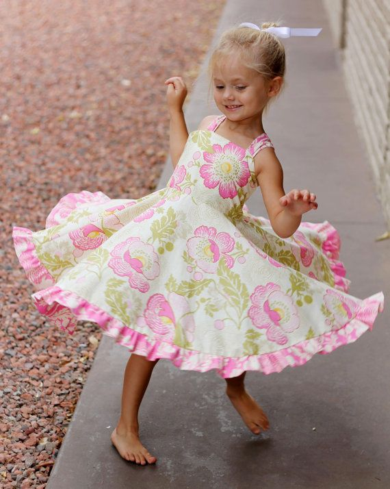 This darling dress has a big skirt that little girls love to twirl in! It also has criss cross straps that pleat in the front and back, with an elastic scrunch back. It is super easy to make!    This comes in sizes Newborn to 6t.    This fun and easy project can be made without a serger. Your PDF tutorial includes all the patterns and instructions you need to complete the dress. You will receive a PDF eBook with easy step by step instructions including full color photos and a full sized…