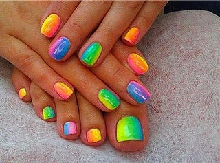 Summer rainbow nails - beach anyone?  (paint each nail with three colors and lightly blend... lots of practice!)  :)