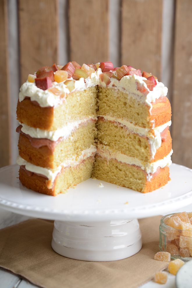 this light and fluffy three layer ginger and orange sponge cake with fresh whipped cream, tangy rhubarb compote topped with sour sweet candied rhubarb and crystallised ginger