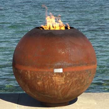 """This modern steel firebowl would go beautifully with the wood and stonework often found on a Craftsman-style home. Design by John T. Unger Studio. This model's called the """"Fireball"""" and goes for $3000."""