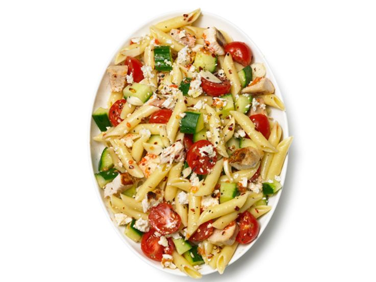 Pasta Salad With Chicken, Cucumber, Cherry Tomatoes and Feta recipe from Food Network Kitchen via Food Network