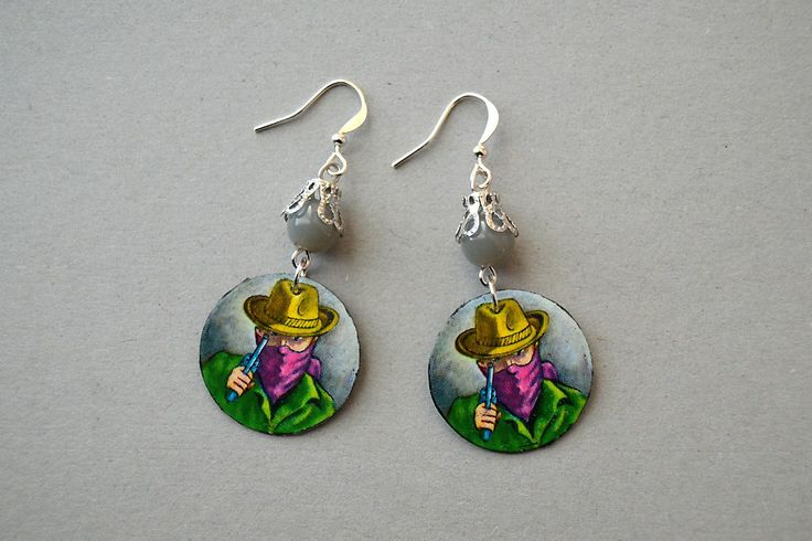 """Earrings made of chips from the Finnish board game """"African Star"""" and pearls. Minka / www.madeby.fi"""