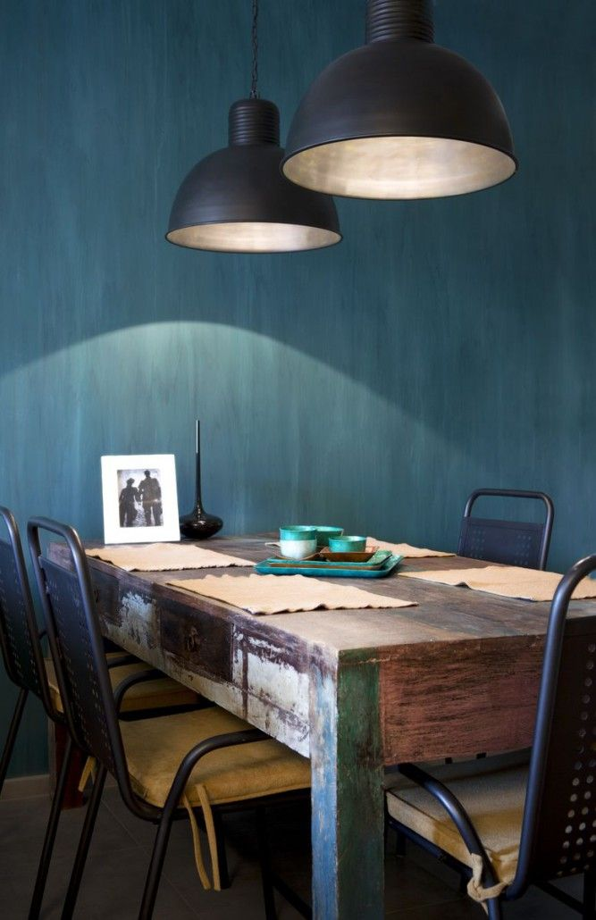 Indian recycled dining table with industrial chairs.