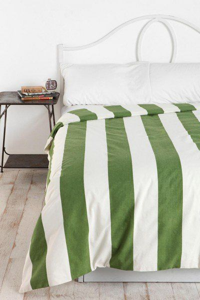green and white cabana striped duvet cover in white bedroom