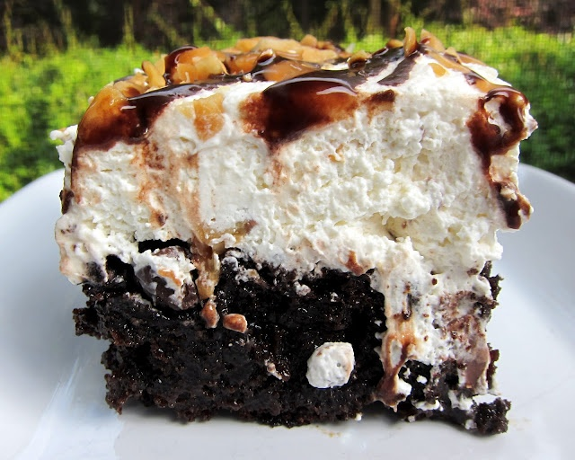 Snickers Cake- It's over the top! This cake is similar to other candy bar cakes, but on steroids. It's actually better the second day. Be warned - this is super rich! Make sure you have plenty of people to share it with!