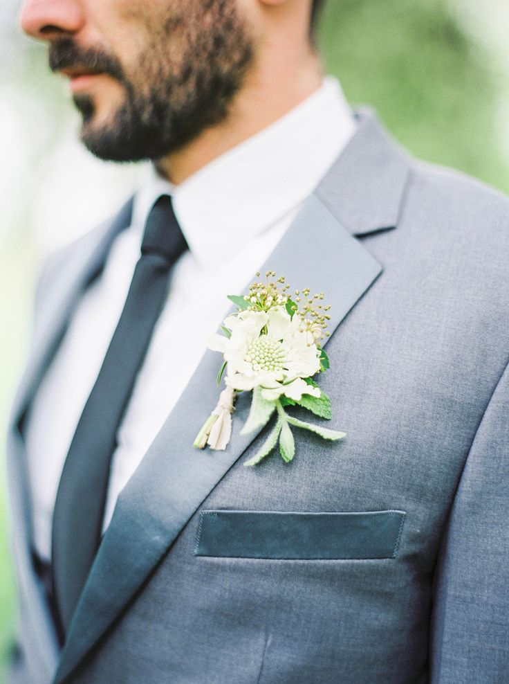 Organic white + green boutonniere: http://www.stylemepretty.com/collection/2880/