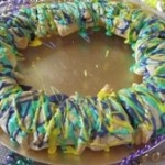 Easy King Cake made with crescent rolls-my most requested recipe from http://www.amazon.com/Holly-Cleggs-Terrific-Coast-Favorites/dp/0981564003?=waf=wwwhollyclegg-20   #Mardi Gras #cake  www.hollyclegg.com