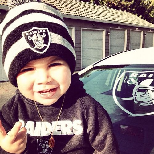Love the football team idea. Hoodie & beanie with some sagged diaper hangn out skinnys.
