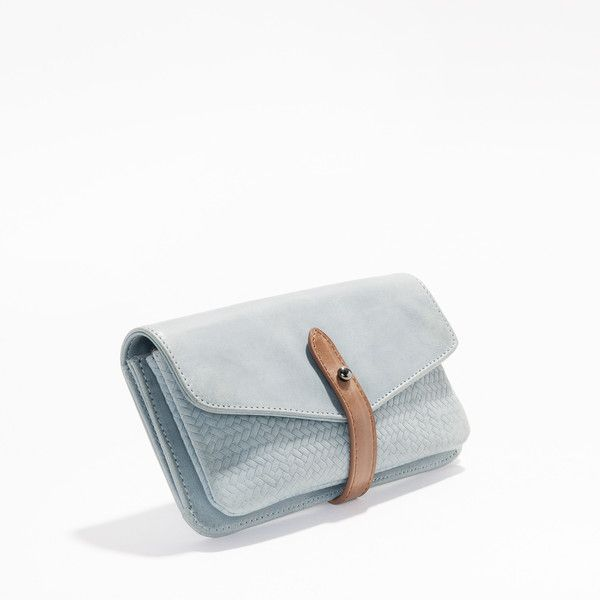 A versatile, Limited Edition ladies wallet made of beautiful soft leather with tan trims, a detachable zip-up coin purse and lined with top quality 100% cotton.
