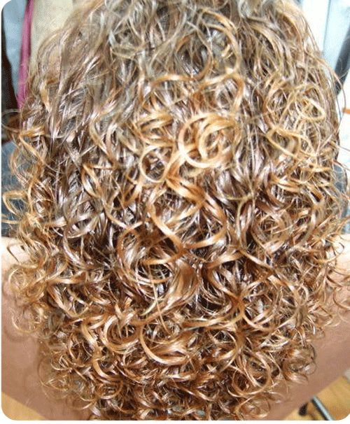 highlighted perm with big, bouncy curls