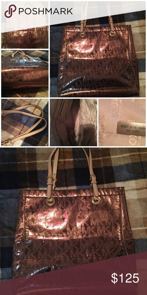 Michael Kors beautiful large metallic copper tote Large sized bag BEAUTIFUL COLOR love this exact everything lol I've had this same bag before which isn't Out of the ordinary in fact I have sold the same bag of almost every bad I have listed sometimes upset more than three times LOL but for some reason this specific style and color is hard to come by I've only had this Bags color  twice Michael Kors Bags Totes