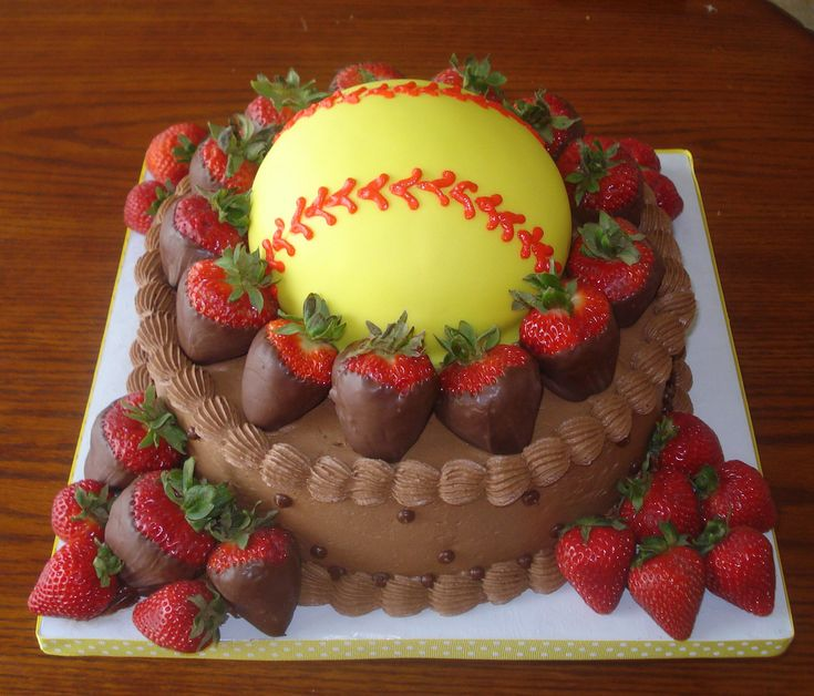 chocolate cake with fondant ball and chocolate covered strawberries.