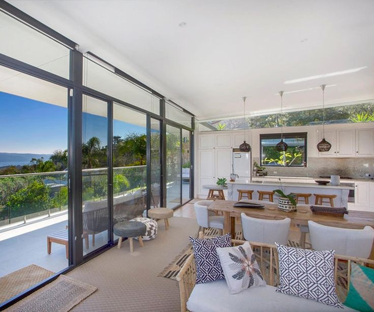 Spanning three levels, the luxury Northern Beaches property is surrounded by bushland and offers far-reaching ocean and headland views.