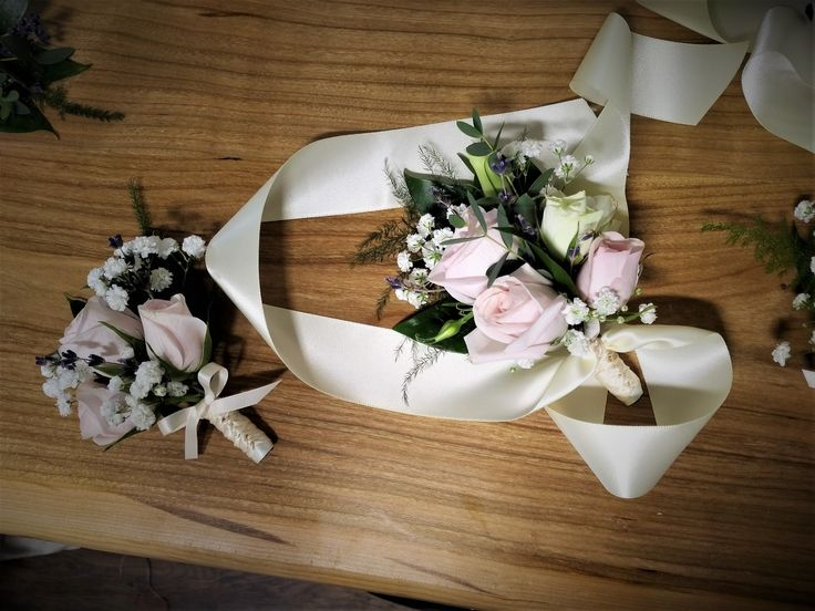 Elegant, soft, simple wrist corsage for the special ladies of the wedding party.  Spray roses, lavender, baby's breath, fern, italian ruscus...