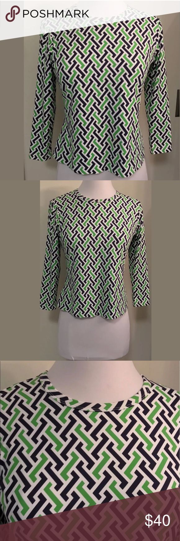 "J McLaughlin signature top 3/4 sleeves J McLaughlin Size XS 91% nylon, 9% spandex  Pullover style White with navy and lime green geo print Excellent condition 100% authentic  Approx. Measurements  (flat/unstretched) Under arms across the back 18"" Shoulder to hem down the back 19"" Around bottom hem 34 ""  Shoulder to end of sleeve 17.5 "" j mclaughlin Tops"