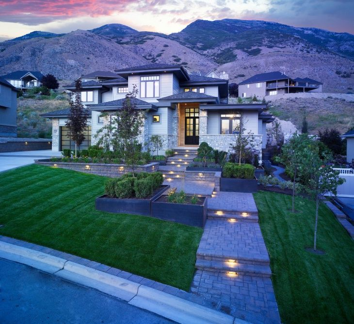 Landscaping Ideas For Sloped Front Yard: This Front Yard Landscape Has Sloped Garden With Lighted