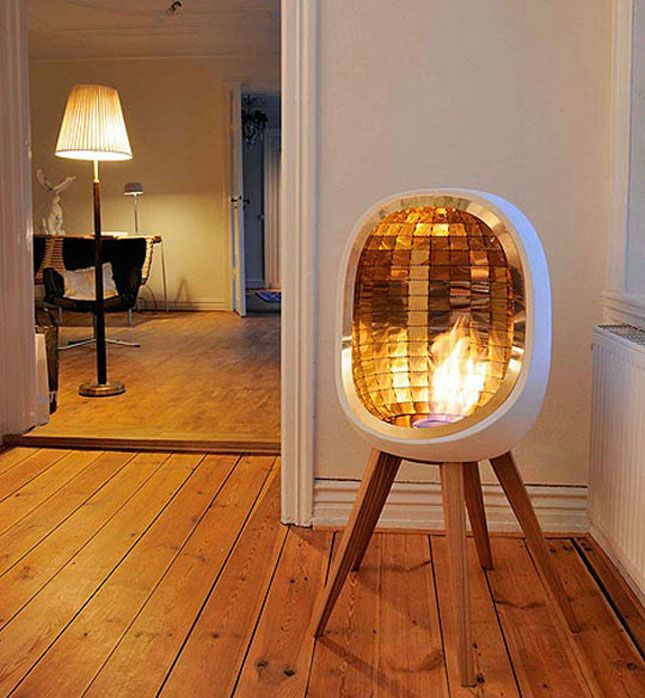 Piet Indoor Stove (concept): This beautiful fireplace / stove by Fredrik Hylten- Cavallius is as lovely as it is functional. It features brass reflectors making the whole room warm up instantly, and the fire is powered by ethanol, eliminating the need for a chimney.
