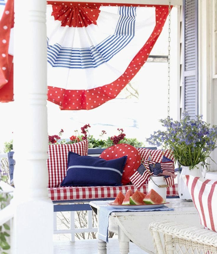 Patterns with Punch for 4th of July or Flag Day ~ A crisp white cottage porch pays tribute to the grand old flag in a casual, homey style. The patriotic look on this porch comes from a strong assortment of patterns. Oversize bunting in stripes and polka dots, a striped rug, and pillows in stripes, polka dots, and gingham emblazon the porch in red, white, and blue. Here is the correct link: http://www.bhg.com/holidays/july-4th/decorating/4th-of-july-home-decorating-ideas/