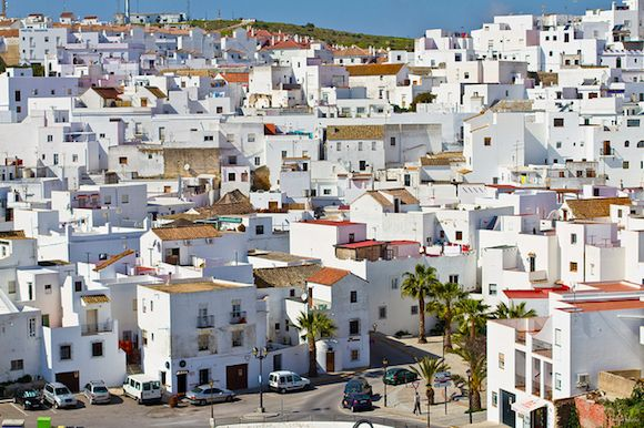 Vejer de la Frontera, a tiny hilltop town at the tip of Spain overlooking the Strait of Gibraltar. The town, like many in the Andalusian region, is split into two parts: the old Moorish medieval quarter and the newer district with characteristic pueblos blancos, pictured here. Flickr user Kurt Schmidt captured this image using a Canon EOS 7D on a recent jaunt through Spain.