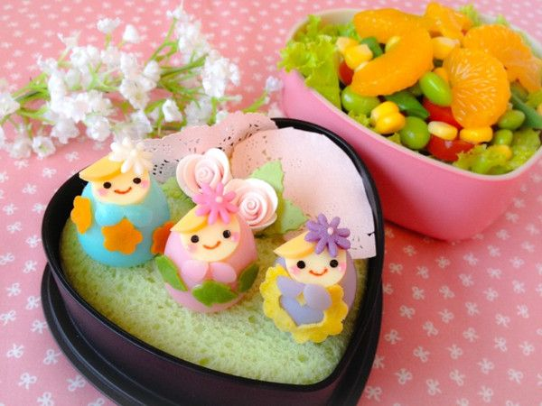 Matryoshka Doll Bento  This bento creation has to be one of my favorites. I must credit this bento idea to a pinterest bento that I saw, I followed the idea of using colored quail eggs for the body and cheese for the face/hair, but decorated the Matryoshka doll in my own way!  http://en.bentoandco.com/blogs/news/10545097-matryoshka-doll-bento