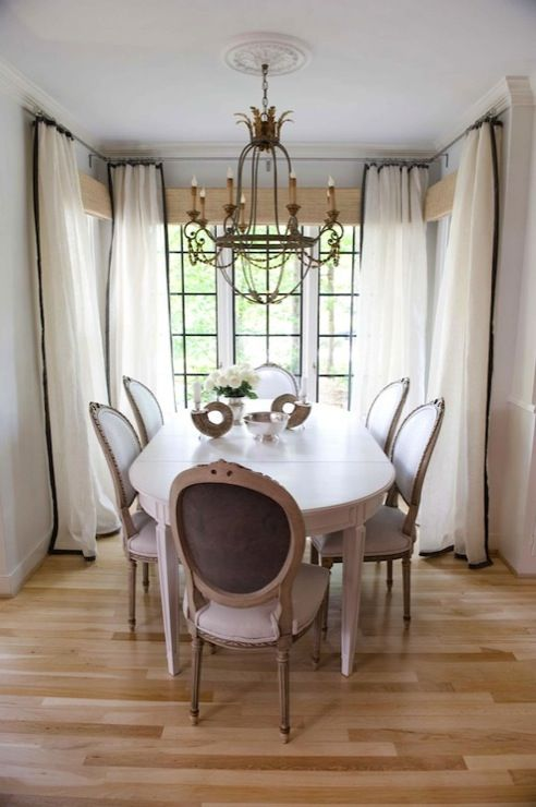 Curtains with black ribbon trim and French tablechairs