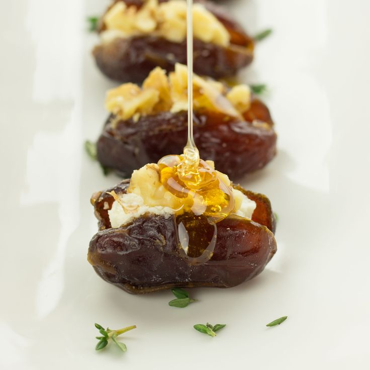 Dates originally stuffed with goat cheese, walnuts ... Drizzled with honey and thyme garnish . Will try my vegan cheese ... I think it will work well