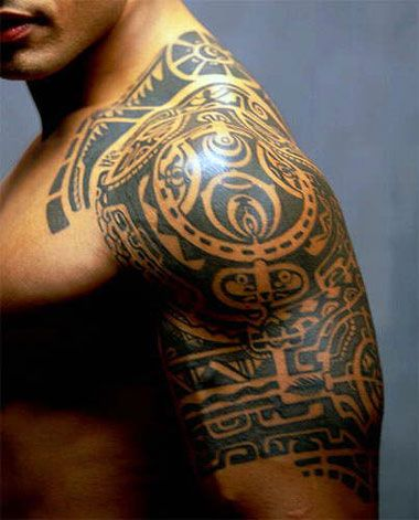 The Rock showing off his Polynesian Tattoo
