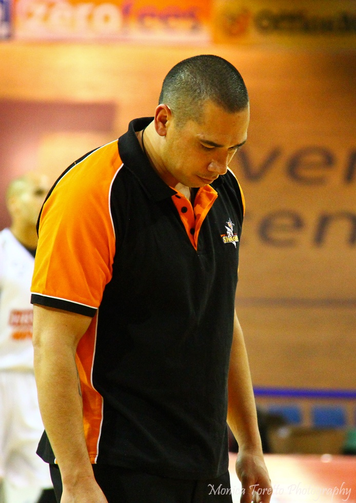 Southland Sharks Coach Paul Henare taking it all in as the game is stopped momentarily while his player lies on the court injured.