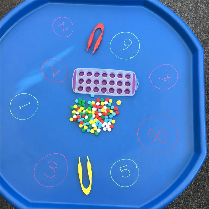 Counting Pom Pom tuff tray for fine motor skills.