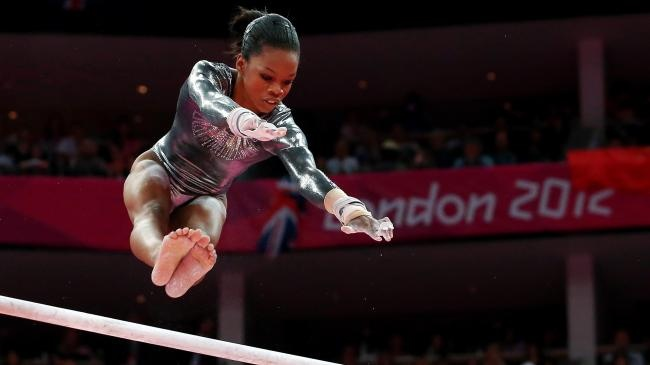 Gabby Douglas competes in the Artistic Gymnastics Women's Uneven Bars final on Day 10 of the London 2012 Olympic Games at North Greenwich Arena on August 6, 2012